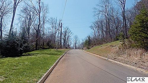Single Family Lot - New Market, TN Beautiful lot to build that dream home on.  Public water available, 3 bedroom septic approval.  Paved and curbed streets, beautiful mountain views from this lot! This lot is wooded, so pick the trees you would like to save when building.  Great location between Dandridge and Knoxville so enjoy all this area has to offer.  Great Smoky Mountain attractions, Cherokee and Douglas Lake, Sevierville, Pigeon Forge, and Gatlinburg attractions. Short drive to…