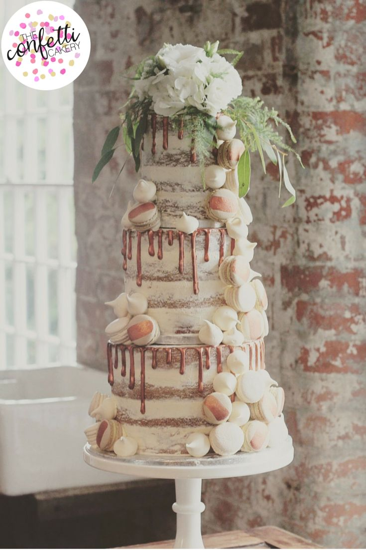 Semi-naked copper drip wedding cake, with vanilla and coffee macarons and meringue kisses by The Confetti Cakery.