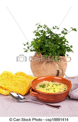 Broth with capellini pasta and fresh parsley.