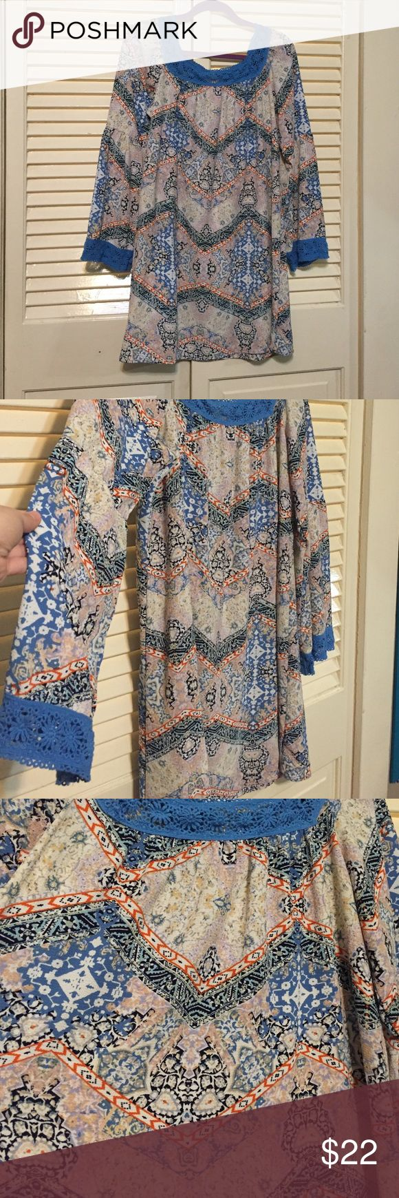 Babydoll style print dress! White blue and orange Chevron/other fun pattern printed baby doll dress! Super soft material, almost silky feeling! Adorable blue trim around neck and belled out sleeves! Dresses