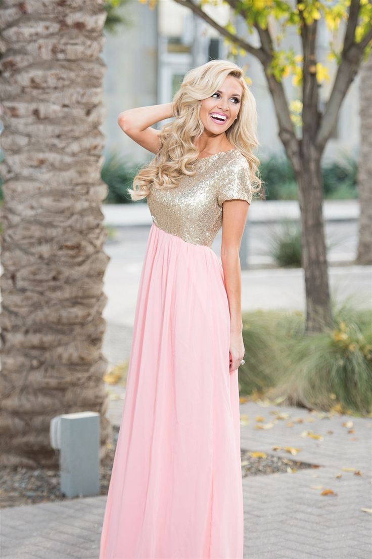 The Elsa features a short sleeve, round neckline bodice that is covered in tiny gold sequins and followed by a long champagne pink chiffon maxi skirt. Dress is fully lined with back zipper closure.