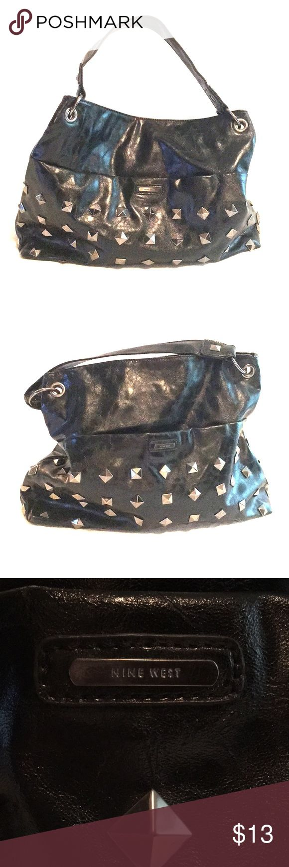 """Nine West Faux leather studded handbag. Nine West Faux leather studded handbag. Good preowned condition. Magnetic snap closure. 2 zippered pockets. Roomy bag 17"""" width. 14""""height Due to weight, this item is not eligible for bundling Nine West Bags Shoulder Bags"""