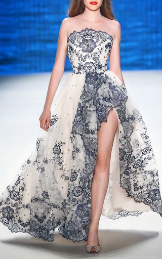 This **Lena Hoschek** Lace Bustier Couture Gown features a fitted bustier top…