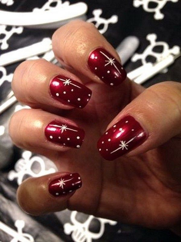 Red Christmas Nail Art with White Designs.