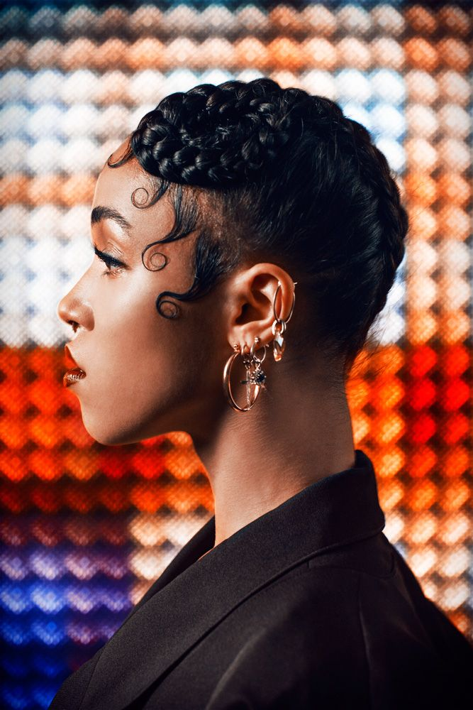 beautiful black hair, two braids updo with crown curl circles tail endings, large spit curls on cheeks & forehead, gorgeous FKA Twigs