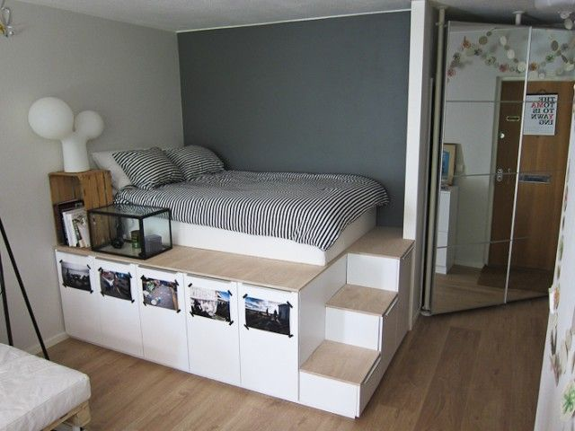 DIY Storage platform bed, useful if cleverly designed for easy roll-out access to all the space under the bed (and steps). since we don't stand up in bed, why waste all that space above it? a nice mural painted on the ceiling (with fairy lights) and filmy curtains around the bed would make this bedroom special.
