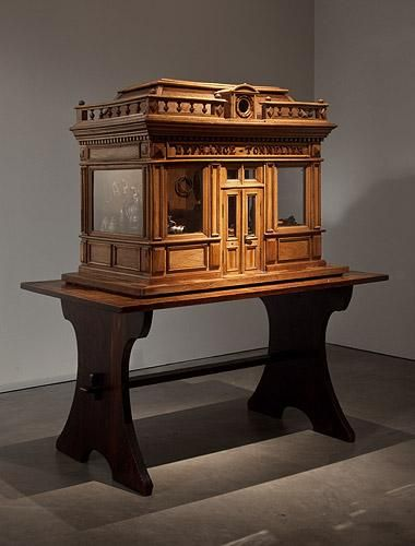 A curatorial composition by Ydessa Hendeles - The Wedding (The Walker Evans Polaroid Project) December 10, 2011 – February 4, 2012.Anonymous (French) Architectural model of a cooper's workshop 19th century Walnut, oak and pine structure, with hand-rolled glass window panes, and brass hardware, on a beech, mahogany and walnut parquetry base. The interior is stocked with miniature cooperage tools and products assembled by the curator from two 19th century collections.