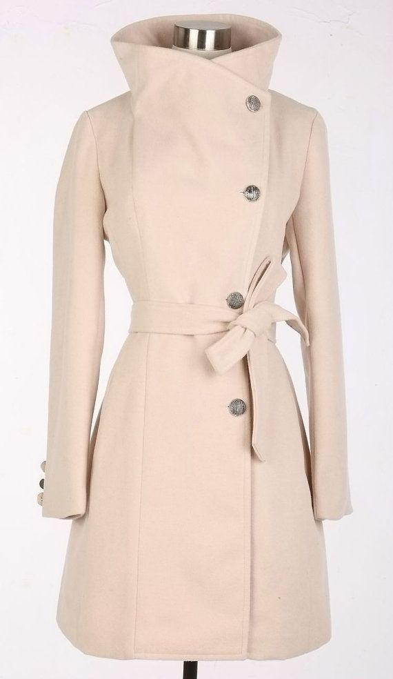 3/4 Wool Coat: Heat up the season Heat up the season in a warm wool-blend coat with half-moon pockets and flattering seams for shape. Fully lined; back vent;