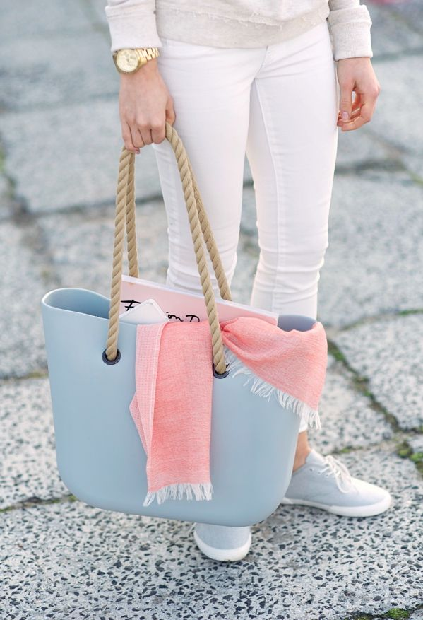 Lovely pastel blue bag and pink scarf.