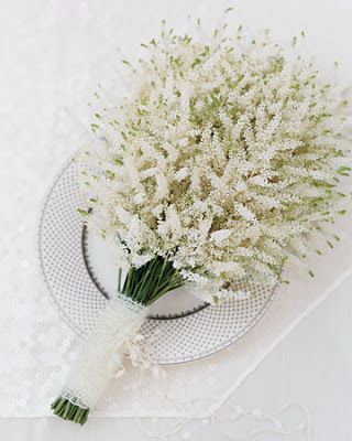 Small & subtle bridesmaid bouquet - or a small spray of off-white flowers is a small basket....