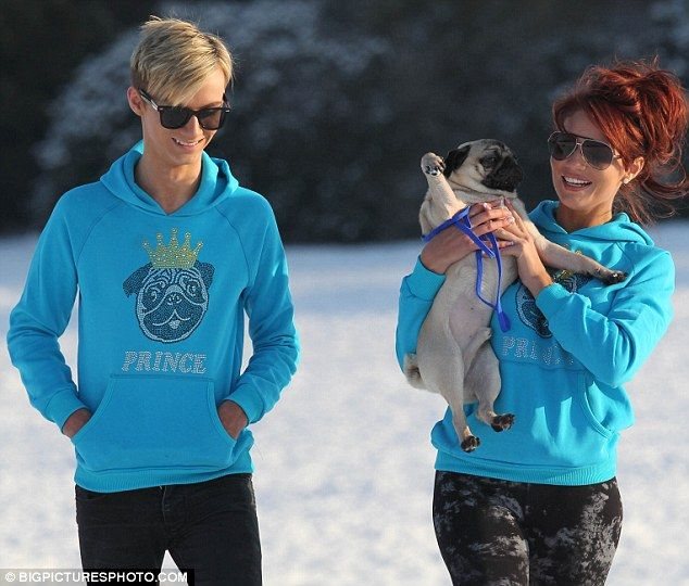 Amy Childs and Harry Derbidge go sledging in matching hoodies featuring her pug dog's face
