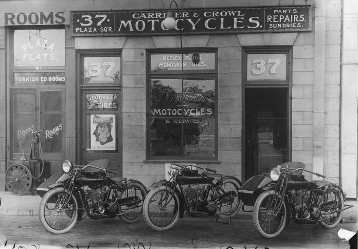 Vintage Indian Motorcycle Store, in the early 1920's .Carriker & Crowl Motocycles, Orange, California, 1916    In 1916, J. Carriker and L. C. Crowl operated Carriker & Crowl Motocycles at 37 Plaza Square, in Orange, California. Like most early motorcycle dealers, Carriker & Crowl also sold bicycles.    The entrance to the Plaza Flats Furnished Rooms, located at 35½ Plaza Square, is to the left of the motorcycle shop. There is a gasoline pump on large wheels in front of the doors.
