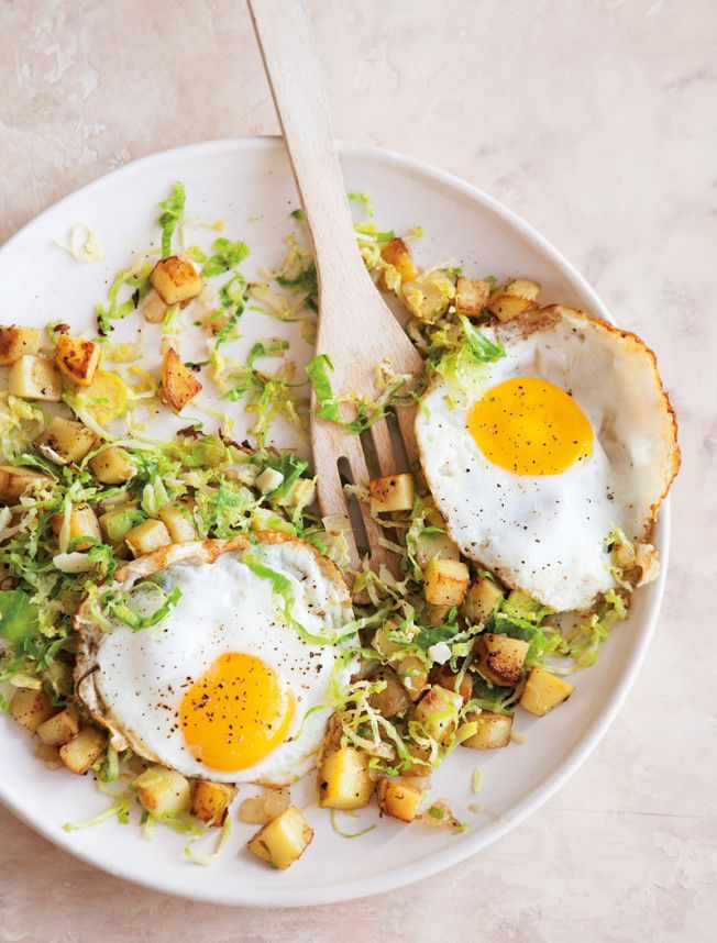 {Brussels sprouts and potato hash with fried eggs.}
