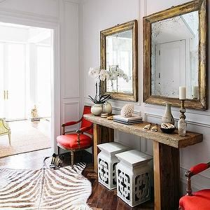 Hardwood Herringbone Floor - Two mirrors, animal rug, two chairs, two garden stools, long table