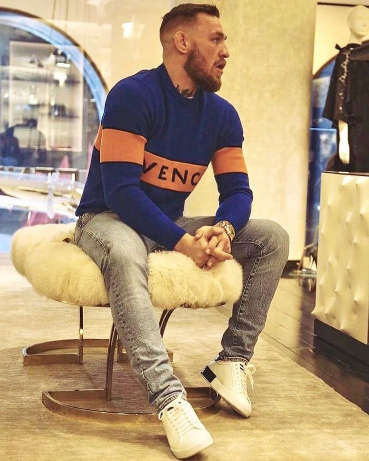 Conor McGregor fights the cold weather in a Givenchy blue sweater