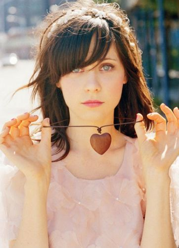 Zooey Deschanel - I really really want her bangs, just can't pull them off though. Damn.