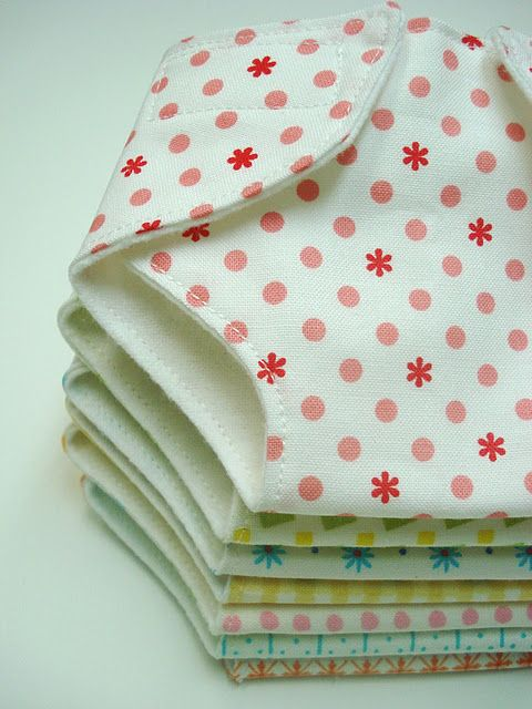 the dolly diapers.  I used a small little print lined with   white flannel for each diaper. Lori Holt