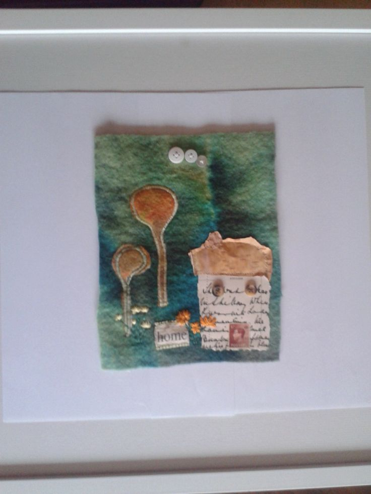 mixed media - house is made from old postcard with silver birch bark roof, postage stamp door, hand made felt trees