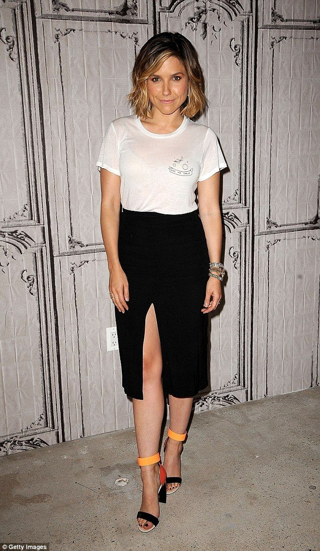 Twice as nice! Later in the day, Sophia was wearing a sheer white shirt and black thigh-hi...