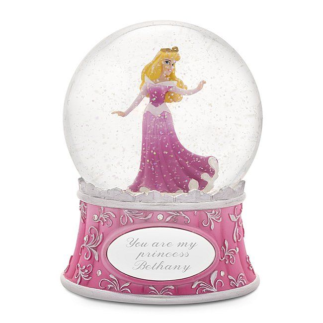 The personalized Disney Showcase Princess Aurora Snow Globe is the perfect gift for the Sleeping Beauty and Disney fan in your life. Designed exclusively for Things Remembered, the snow globe's pink base is detailed with silver embellishments and clear crystals. Confetti snowflakes swirl inside the globe when shaken.