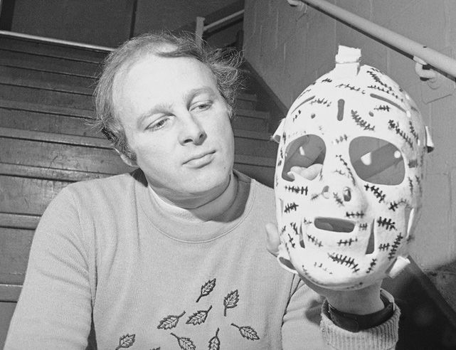 """Gerry Cheevers holding his famous """"Stitches"""" mask 