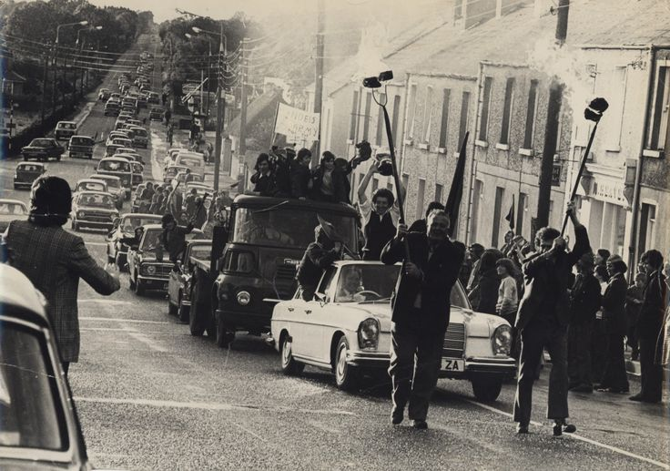 1974 Longford Champions, Mostrim GAA, are paraded through Edgeworthstown, led by sods of blazing turf.  © GAA Oral History Project