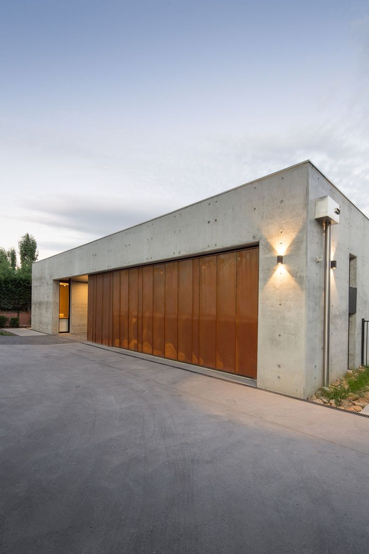 Banks-Street-Yarralumla - corten garage and concrete.   Builder Ross Catoi, Full Circle Constructions. Architect - Collins Caddadye .