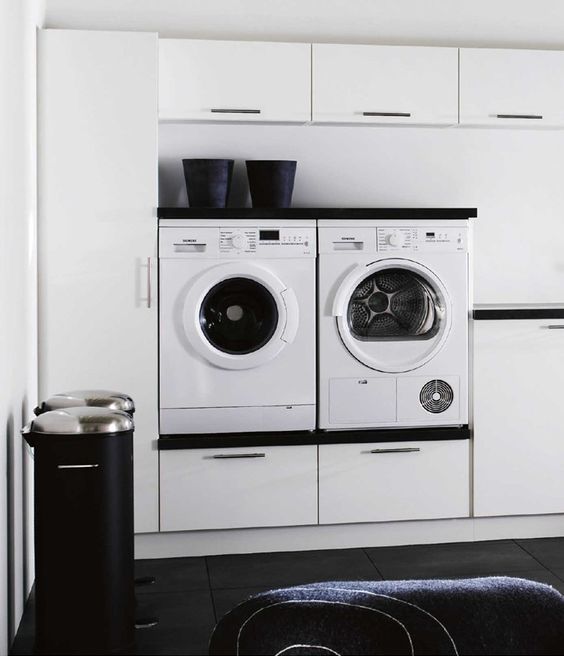 Designing the ultimate laundry, all the tips and tricks you need! Stylish black and white laundry with appliances elevated off the ground for ease of access #Appliances