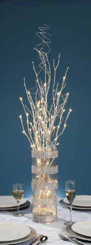 27 inch Silver Glitter Branch with 20 Warm White LED Lights - Battery Operated Darice,http://www.amazon.com/dp/B00EJ3G8L4/ref=cm_sw_r_pi_dp_XBfGsb16G59BPVK8