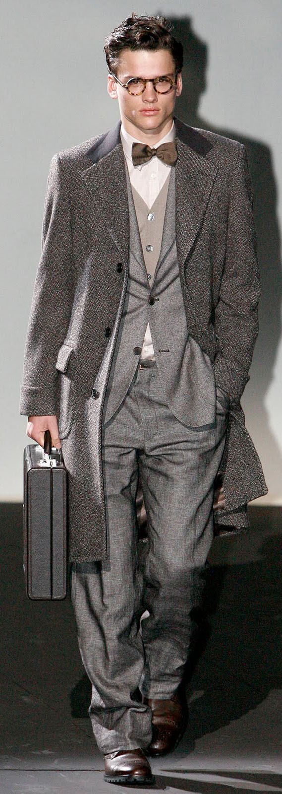 by Corneliani. Thinking hard about the brown bow tie , shoes and glasses with that gray. The texture just barely makes it work IMHO.