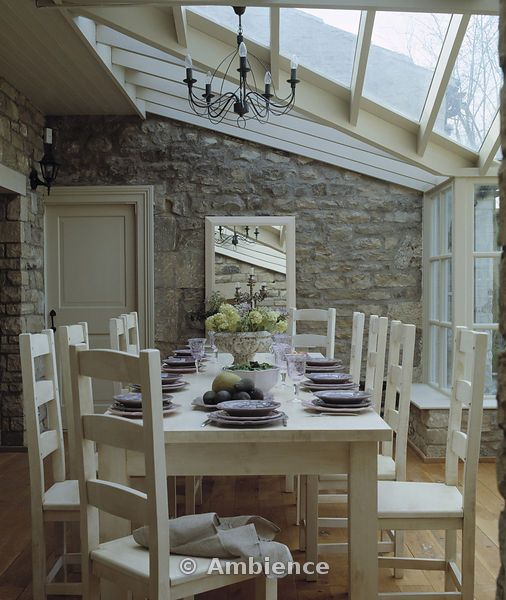 Ambience Images | Contemporary neutrally coloured diningroom within conservatory extension If you like this pin, why not head on over to get similar inspiration and join our FREE home design resource library at http://www.TheHomeDesignSchool.com/signup ?