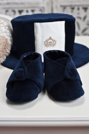 """Baby boy bootees, made of an elegant navy blue velvet, matching the """"O'Malley"""" boy suit."""