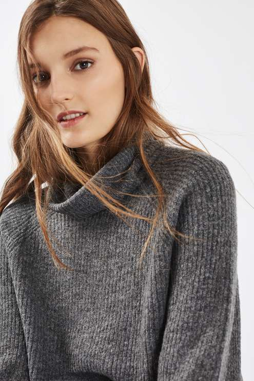 The cold weather is calling for chunky knits - this mid-weight jumper in charcoal is a wardrobe essential this season. Featuring a roll neck and blouson sleeves with a super-soft feel, it comes in an oversized fit, perfect for layering over jeans or a trophy skirt. #Topshop