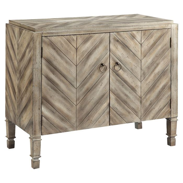 picture perfect furniture. perfect for holding extra table linens in the dining room or board games den this cabinet showcases a plankstyle chevron design picture furniture