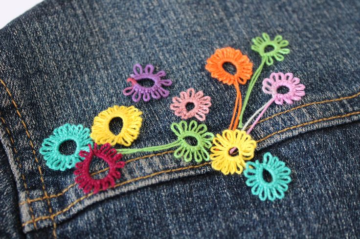 with little rings and picot you can do a garden in your jacket :) tatting