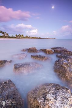 5 Things to Keep in Mind When Shooting the Ocean:  A rock jetty in Key West, Florida. As the tide rose, it got more and more submerged in the water and a shutter speed of 10 seconds really let me get a nice movement in the clouds and turn the water to mist.