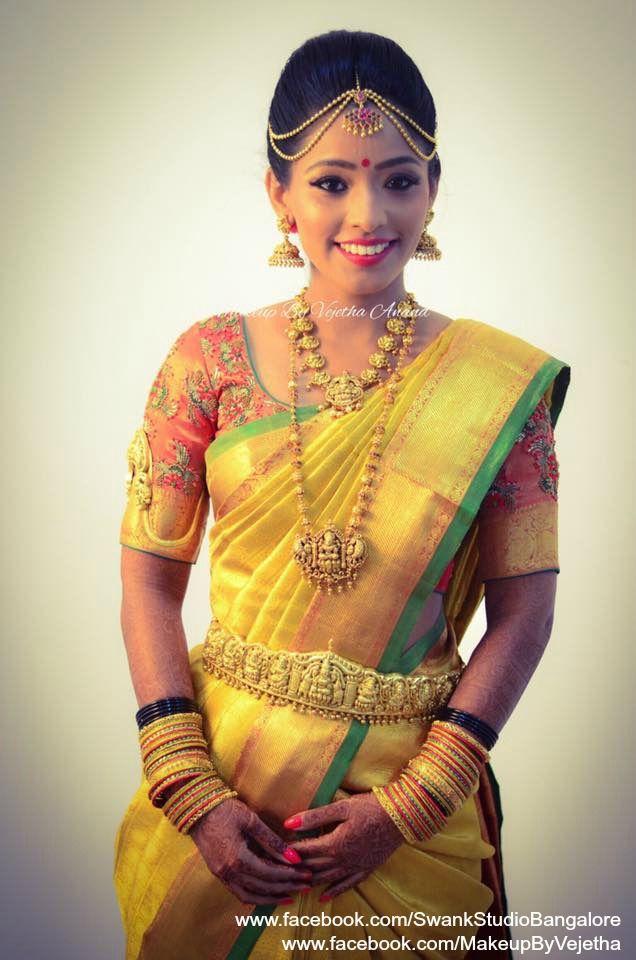 Our bride Akhila looks radiant for her muhurtam in bridal silk saree, jewellery and makeup. Makeup and hairstyle by Vejetha for Swank Studio. Photo credit: Manish Ananda. Coral lips. Bridal jewelry. Jhumkis. Bridal portrait. Bridal hair. Silk sari. Bridal Saree Blouse Design. Indian Bridal Makeup. Indian Bride. Gold Jewellery. Statement Blouse. Tamil bride. Telugu bride. Kannada bride. Hindu bride. Malayalee bride. Find us at https://www.facebook.com/SwankStudioBangalore