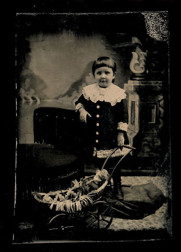 http://www.ebay.com/itm/tintype-photo-little-girl-with-bowl-haircut-doll-in-baby-carriage-/352099201720?hash=item51fabf72b8:g:FwEAAOSw2gxY29f0