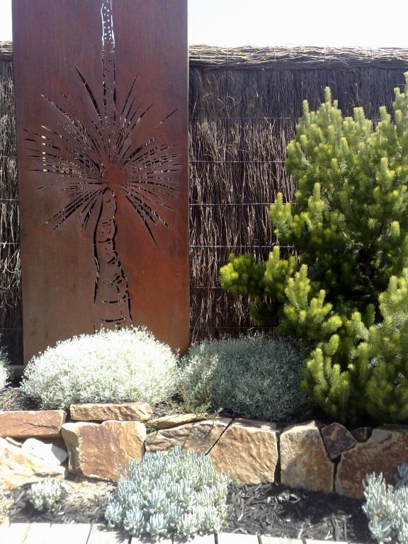 Landscaping by Paal Grant, laser cut metal wall art by www.entanglements.com.au