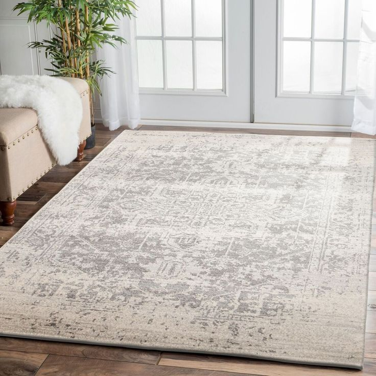 Adding a faded, washed out pattern to your floor's decor will add a unique touch of luxury and sophistication to your home. Our Cíbola Transitional White Silver Designer Rug is a beautiful example of this: