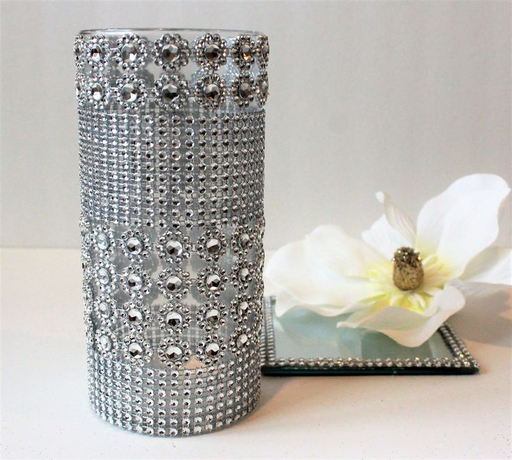 This set included a 8 inch candle holder and a Mirror Tray . A perfect set for any wedding décor or christmas Parties for table décor . This set is very modern and Elegant for any wedding, Tall Cylinder vases that add levels and dimensions to your table . The bling design Which makes the candle holder even more beautiful . You can add floating candles to it and bring your own design ideas to this beautiful glass holder . You can also use the candle holders and the mirrors separately as two…