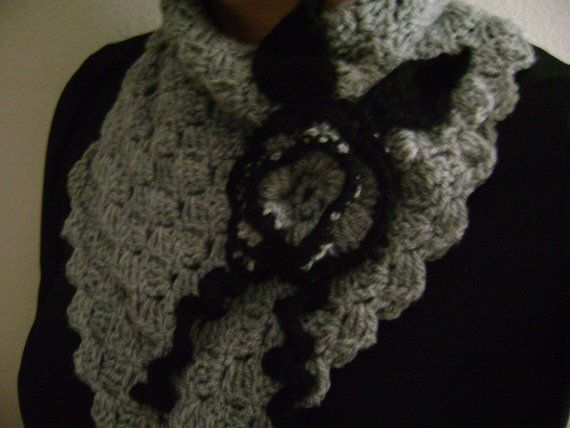 Grey and black button scarf with flower.