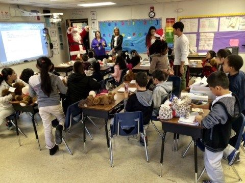 """More than 1,000 children at a Charlotte elementary school will receive gifts from high school """"elves"""" with a little help from Santa.For the 9th year, 60 Olympic High School """"elves"""" dropped off 1,00..."""