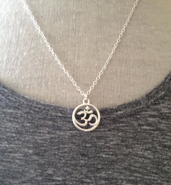 A gorgeous Silver Necklace by Boho Yoga UK.    The little Om Charm is suspended from a Silver Plated strong adjustable Chain.    The Chain can be