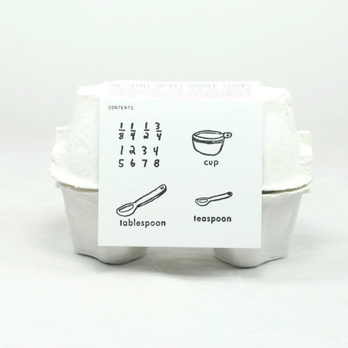 The Recipe Writing Stamp Set. Ok, it isn't cookware, but getting kids to stamp out a recipe is an interactive way to get them to get involved in cooking.
