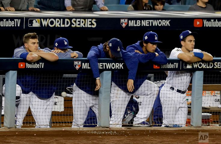 World Series Astros Dodgers Baseball Members of the Los Angeles Dodgers watch as the Houston Astros celebrate their win in Game 7 of baseball's World Series on Nov. 1, 2017, in Los Angeles. The Astros won 5-1 to win the series 4-3. (AP Photo/Alex Gallardo)
