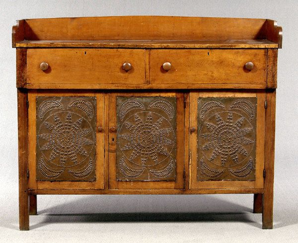 Russell County, Virginia, pie safe, dovetailed and scalloped back panel above tow broadly dovetailed drawers, front and sides with circular and star punched tins, side tins, frame-and-panel back with 2 chamfered panels, 51 h. x 63 W. x 21 D.