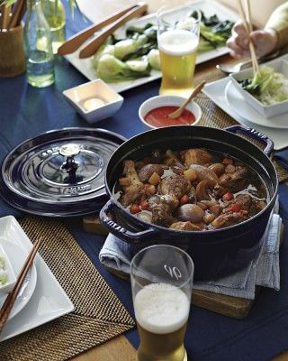 Staub Cast-Iron Round Cocotte #williamssonoma. Amazing lid with spikes that basting while cooking. The most amazing flavors and tenderness will result. Wonderful gift idea for the cook in your family!