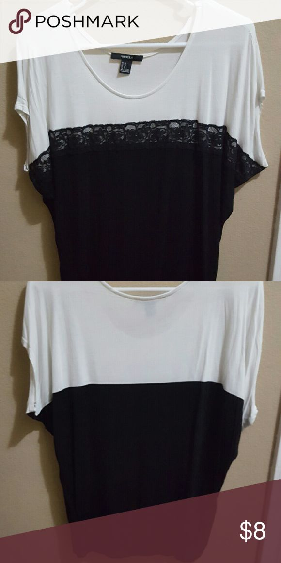 Forever 21 Black and white batwing top You are gazing upon a figure flattering Forever 21 black and white batwing top Forever 21 Tops Blouses