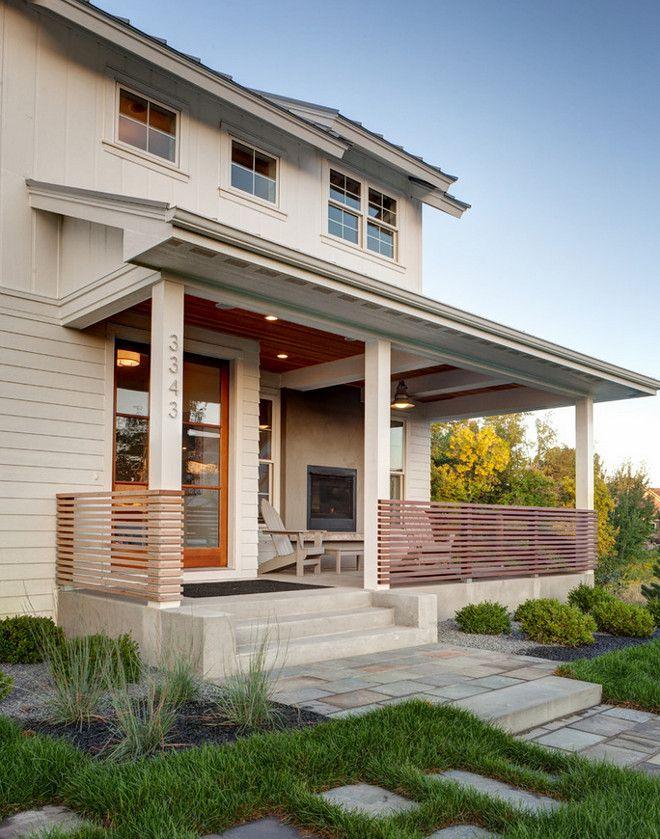 Porch railing. This modern farmhouse porch railing is made out of clear-coated 2x2 cedar spaced two inches apart. #porch #railing AMEK Custom Builders. Martha O'Hara Interiors